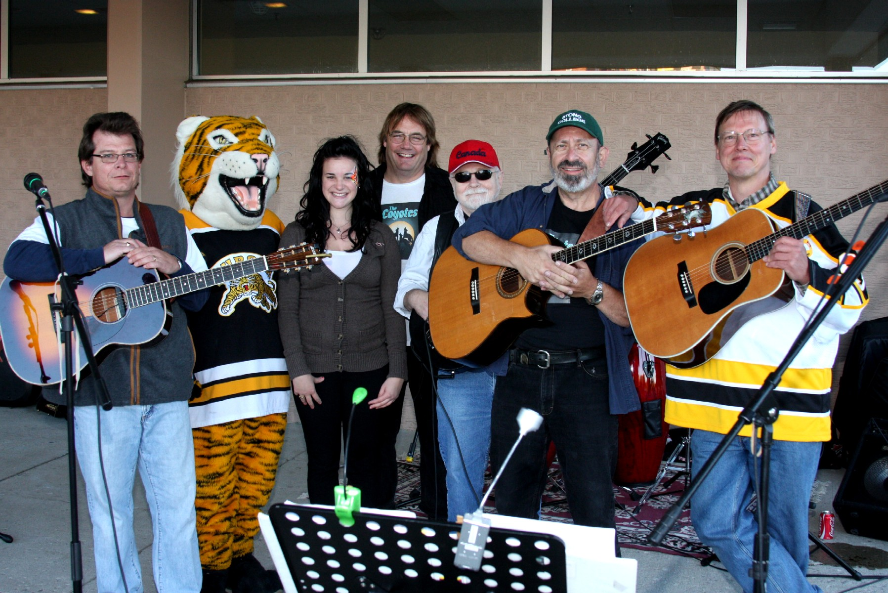 Band posing on stage - Mark,tiger mascot,unknown,Jim DeVries,Paul Snelgrove,Peter,Eric