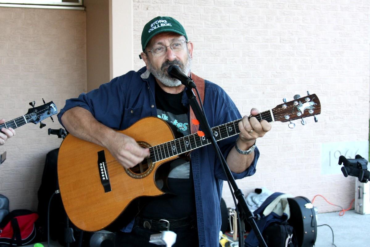 Peter playing guitar and singing