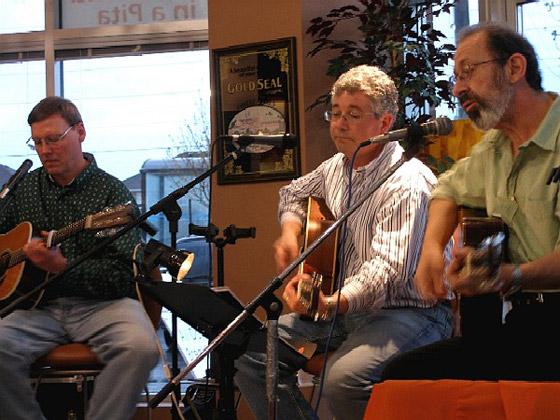 Eric, Burke, Peter playing guitar, Peter singing