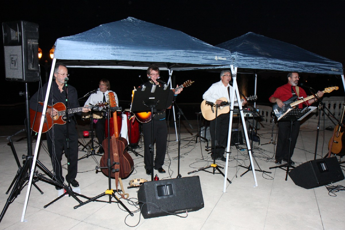 Band playing under canopy
