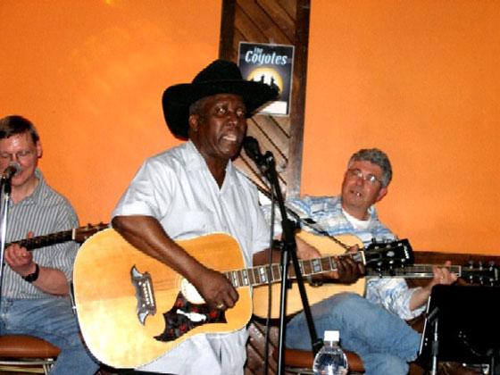 Albert singing and playing guitar,Eric and Burke backup guitar