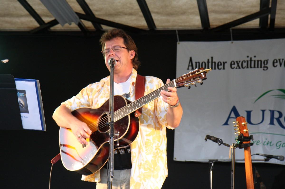 Mark singing and playing guitar