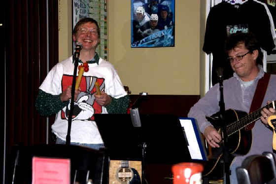 Grinning Eric on percussion, Mark playing guitar