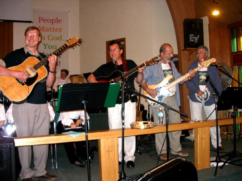 Smiling Eric on guitar,Mark singing & guitar,Peter bass, Burke tambourine