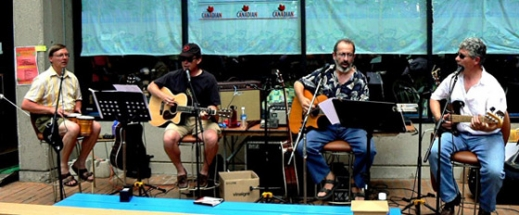 sitting coyotes singing,Eric bongos,Mark guitar,Peter guitar,Burke bass