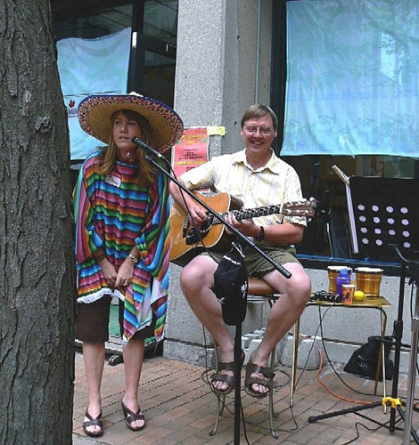 Mexican dressed woman singing,Eric playing backup guitar