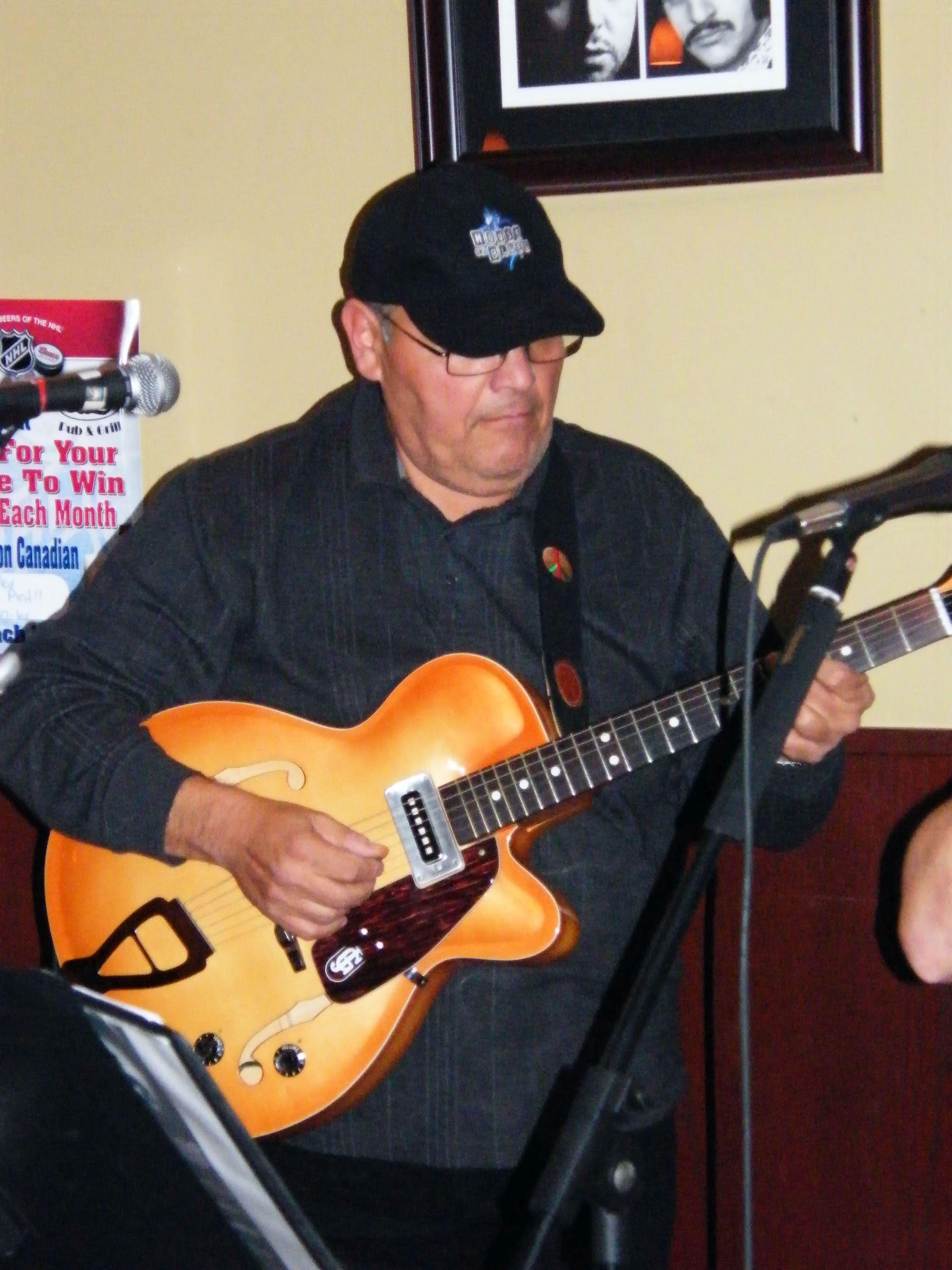 "Big Louie playing Eric's ""Old Italian"" guitar"
