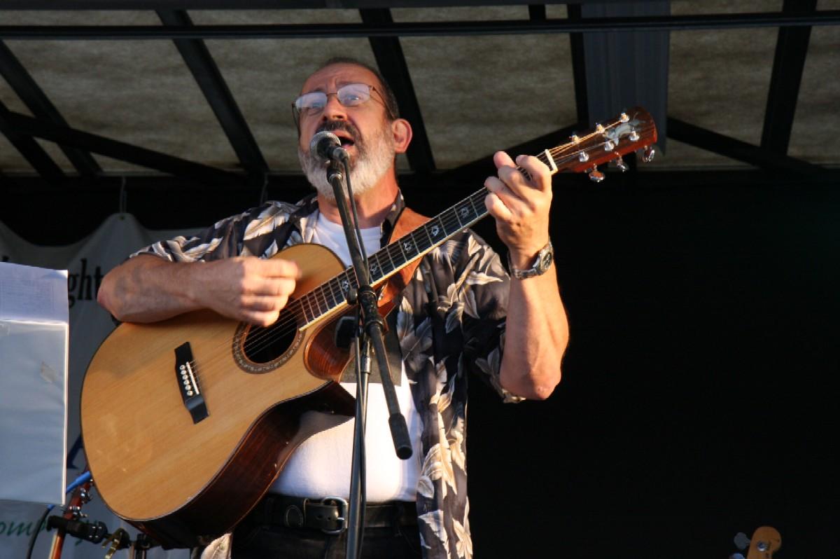 Peter singing and playing guitar