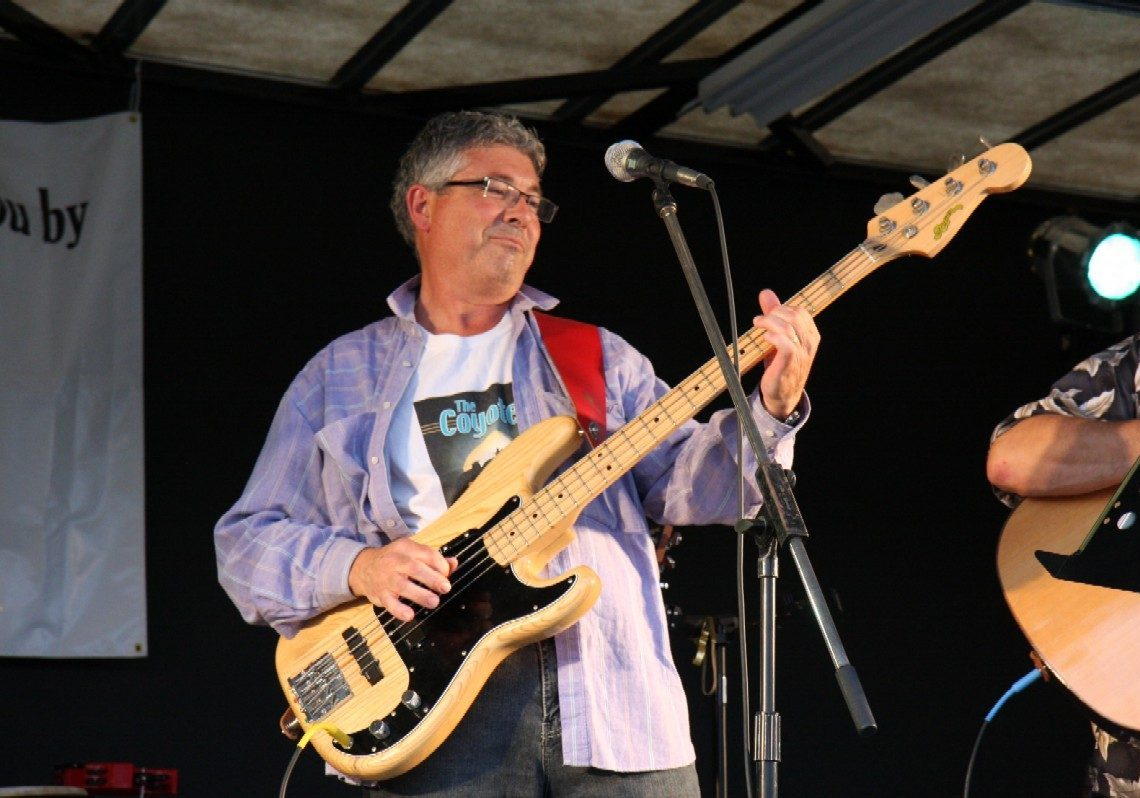 Burke playing bass at Ribfest