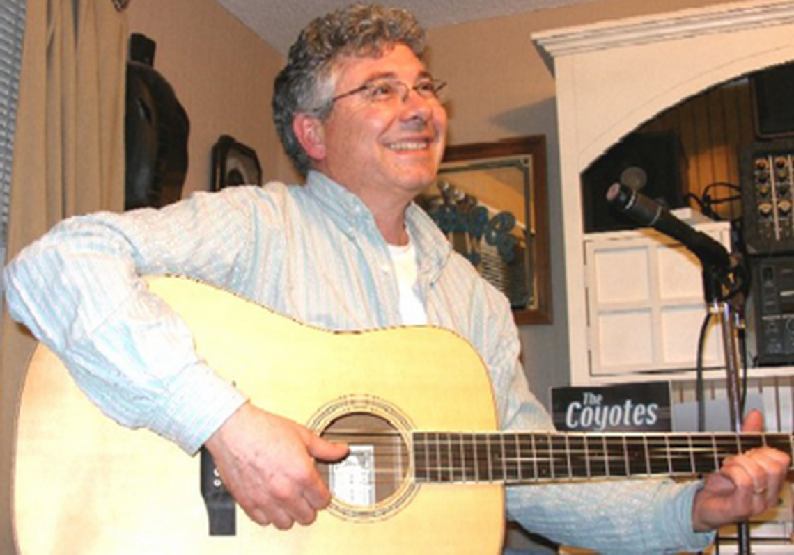 """Burke playing guitar in """"The Den"""""""