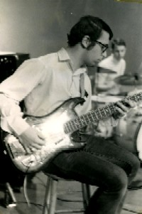 Young Peter playing bass